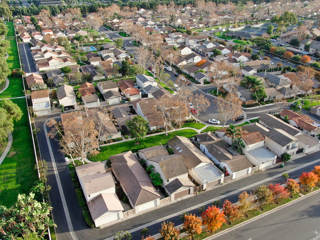 Aerial view of middle class suburban neighborhood with houses next to each other in Irvine